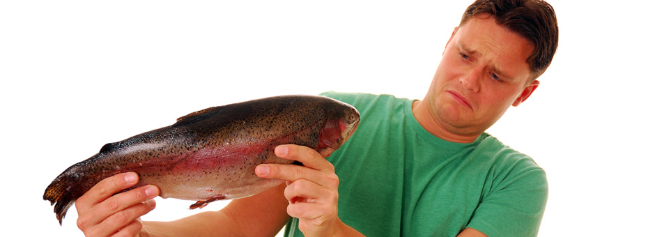 a man holding a fish