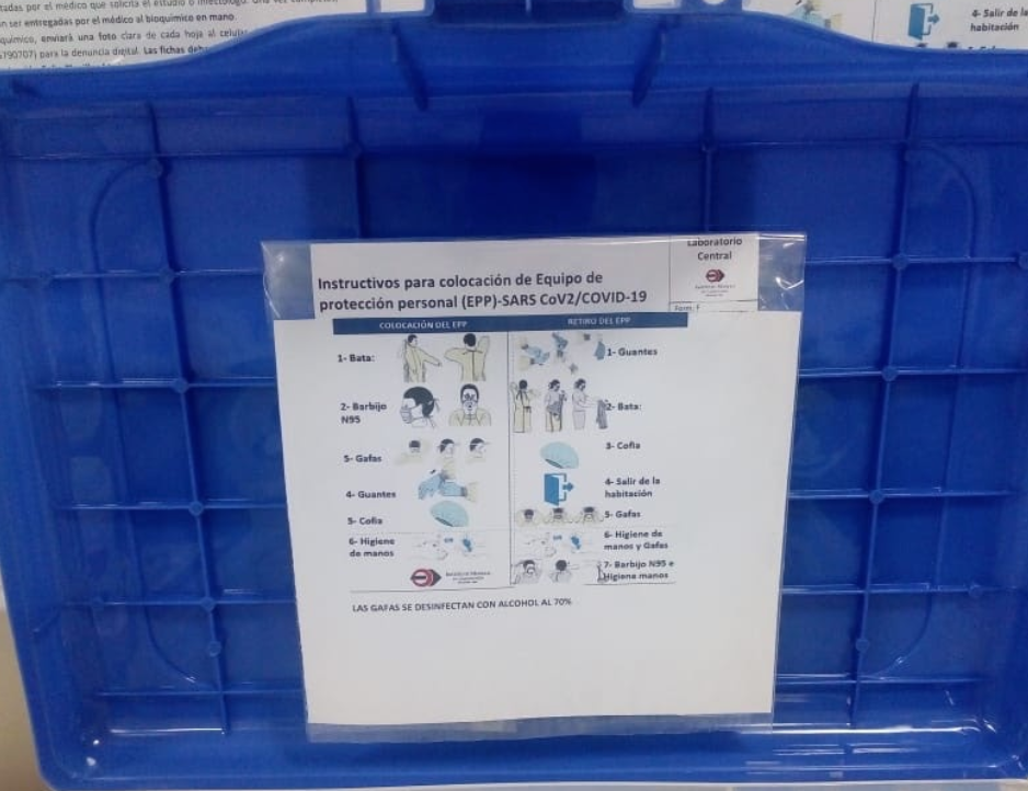 Working standards stuck to the inside of the lid of Covid testing kit