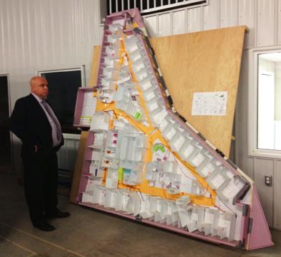 Dan Florizone at the 3P mock up in the warehouse at Moose Jaw, Saskatchewan